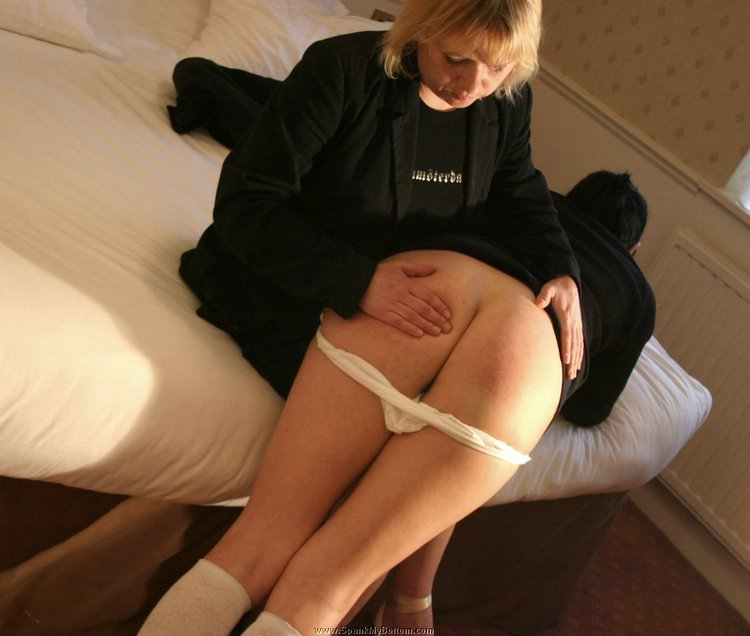 Spanking on the bare bottom 4